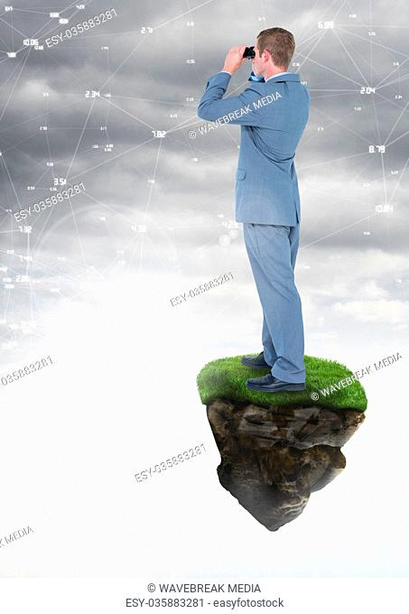 Businessman with binoculars on floating rock platform with interface connecting in sky