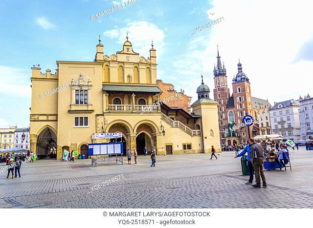 Tourists at the Main Market Square with the view on historical Cloth Hall, Krakow, Poland, Europe