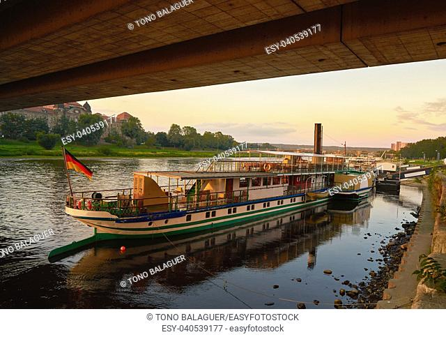 Dresden Elbe river and boats at sunset in Saxony of Germany