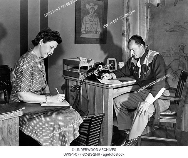 Yoakum, Texas: 1936.A man and his secretary at the Texas Ranger Leather Manufactory