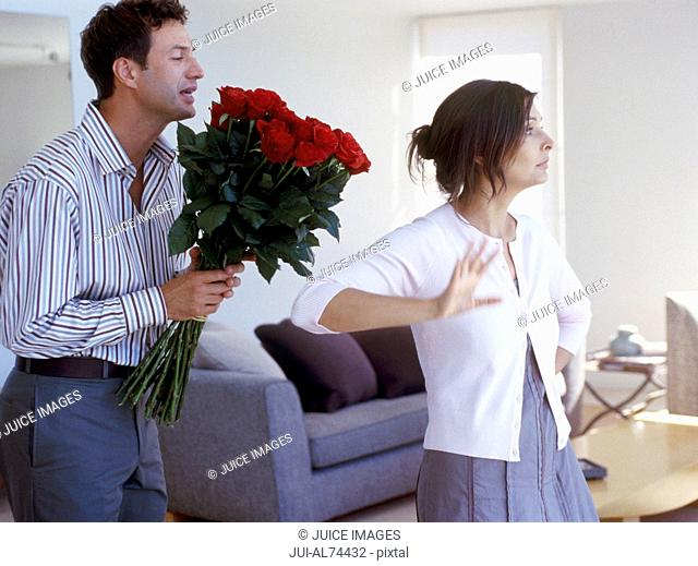 View of a woman refusing roses from boyfriend