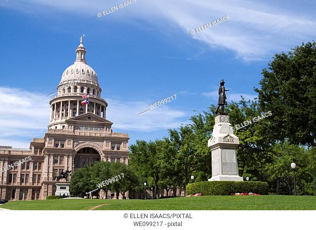 Front of Texas state capitol building or statehouse in Austin with volunteer fireman and Texas Rangers statues