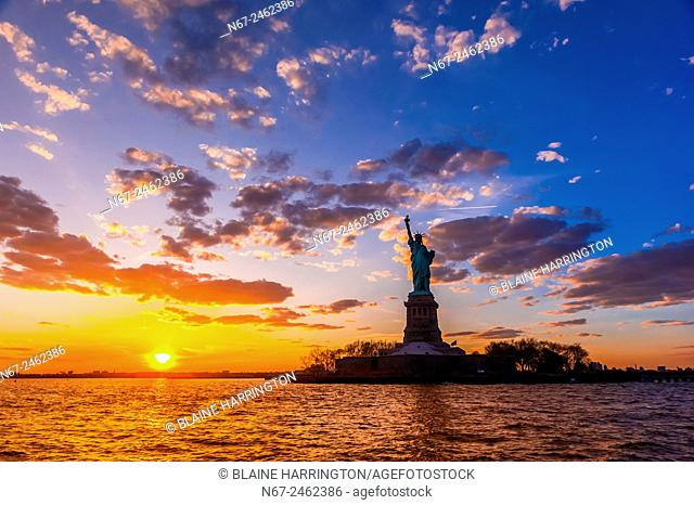 Statue of Liberty at sunset, New York Harbor, New York, New York USA
