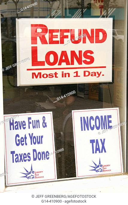 Tax preparer business. Window signs for income tax and refund loans. Miami Beach. Florida. USA