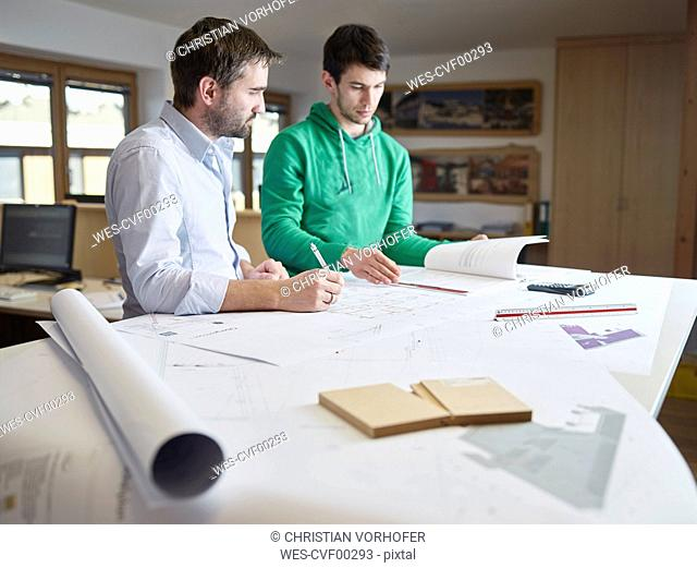 Architects working on construction drawing
