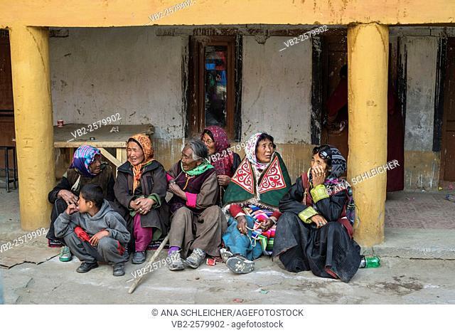 Traditionally dressed nomad women watching the summer festival in Tso Moriri lake, Ladakh (India)