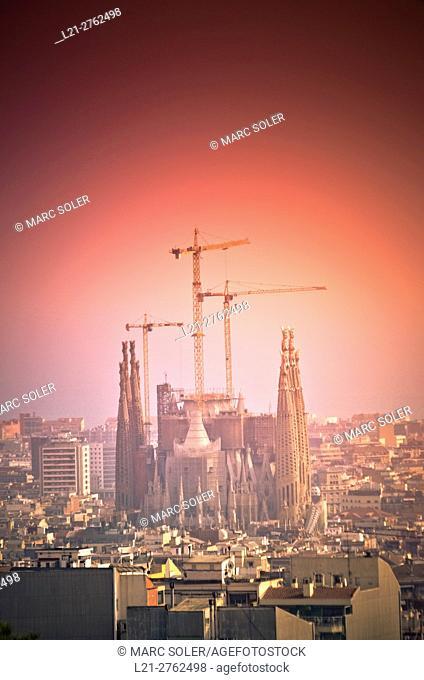 Cityscape. Sagrada Familia designed by Antoni Gaudi architect. Church with cranes under construction. Barcelona, Catalonia, Spain