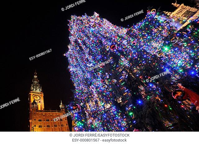 Christmas decoration at Dlugi Targ street, The Belltower of Town Hall is in the background, Gdansk, Pomeranian, Poland, Europe
