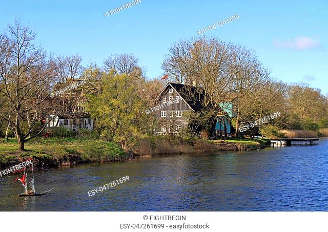 canal Stadsgraven and wooden houses in Copenhagen, Denmark