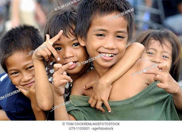 children at carbon market downtown cebu city philippines