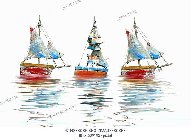 Three crafted sailboats, photomontage