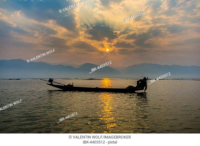 Local Intha fisherman rowing boats with one leg, unique local practice, sunrise, dawn, Inle Lake, Inle Lake, Shan State, Myanmar