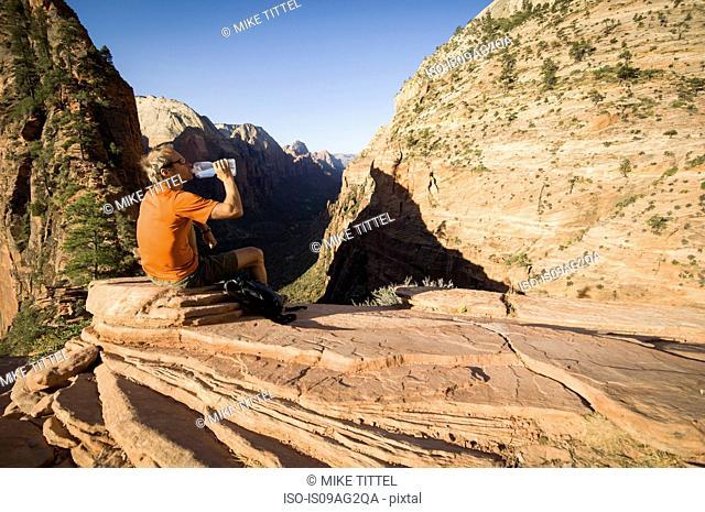 Male hiker taking a break on the Lakeside Trail, Zion National Park, Utah, USA