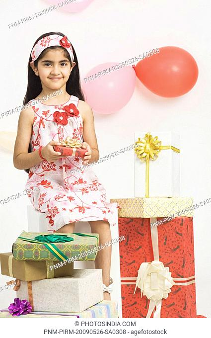 Portrait of a girl holding a birthday present