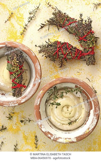 fresh dough in the flowerpot with spices and herbs