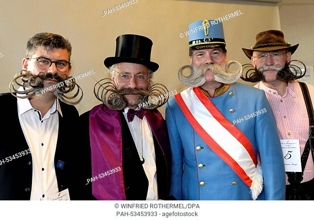 Diebolt Herve (L-R), Juergen Burkhardt, Franz Mitterhauser and Dieter Besuch pose before their appearance in the European Beard Championship in Schluchsee