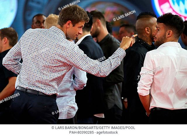 MUNICH, GERMANY - MAY 14: Thomas Mueller has a laugh with Juan Bernat on stage with his Championship ring during the FC Bayern Muenchen Bundesliga Champions...