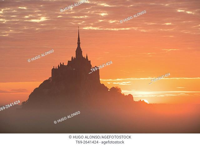 Red sky over the Mont-Saint Michel abbey. Normandy. France
