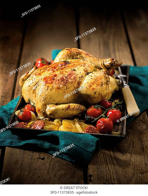 Roast chicken with tomatoes and potatoes