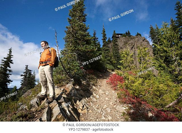 Hiker on Gobbler's Knob Trail leading to the Fire Lookout - Mount Rainier National Park, Washington