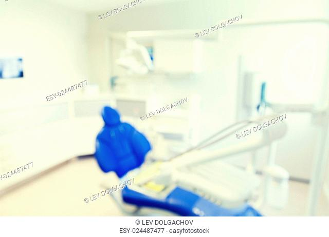 dentistry, medicine and stomatology concept - blurred modern dental clinic office interior bokeh