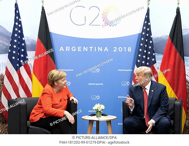 01 December 2018, Argentina, Buenos Aires: Federal Chancellor Angela Merkel (CDU) and Donald Trump, President of the United States