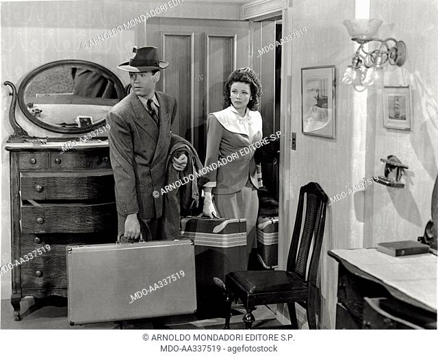 Henry Fonda and Gene Tierney in 'Rings on Her Fingers'. The US actors Henry Fonda and Gene Tierney are leaving a hotel room, luggages in their hands
