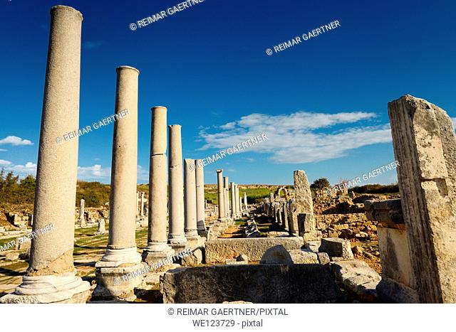 Ruins of stores behind colonade of pillars on main street of Perge archaeological site Turkey