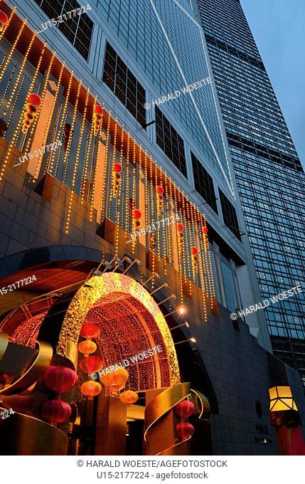 Hong Kong, China, Asia. Hong Kong Central. Decorated tower of the Bank of China (left) next the Cheung Kong Center (right)