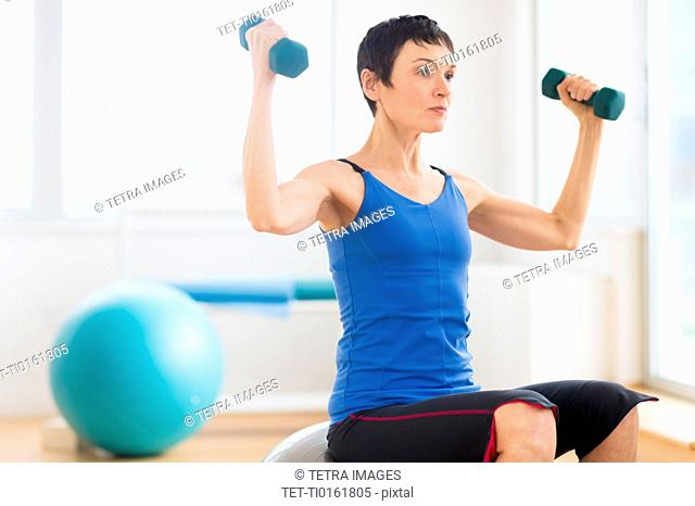 Mature woman exercising in gym