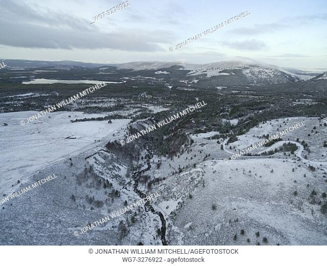 AVIEMORE, SCOTLAND, UK - 17 Jan 2019 - Aerial snowy landscape showing the snowy mountains of the Cairngorms near Loch Morlich with the Rosiemurchus forest also...