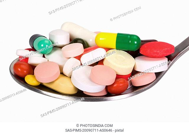 Close-up of a spoon full of pills
