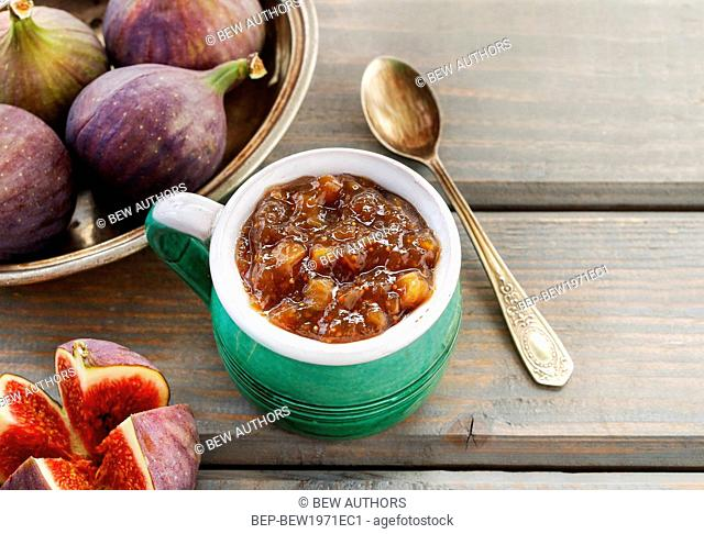 Jug of fig jam and bowl of fresh figs. Healthy dessert