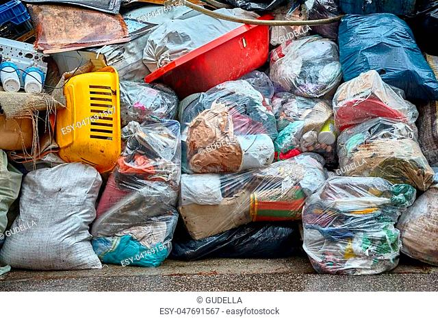 Garbage bags piled up in a hill