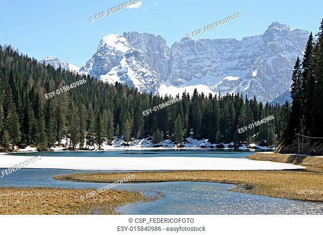 frozen Alpine Lake Misurina with dolomiti mountains