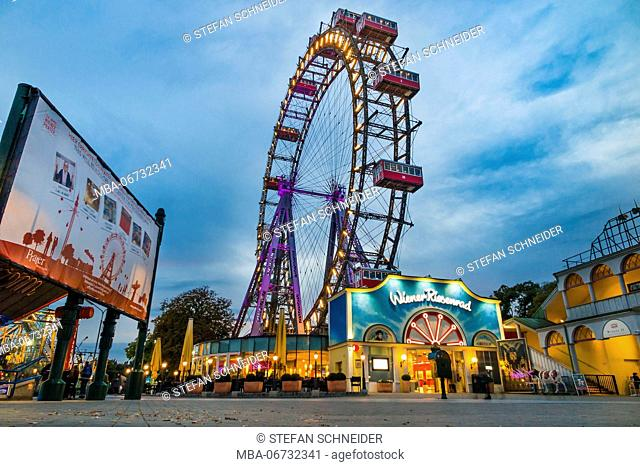 Evening mood to the fairground of the Viennese Prater and the big wheel in the background