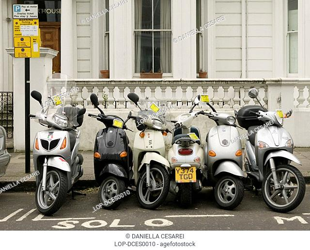 England, London, Kensington, Suspended motorist bay with fined bikes in Kensington. The penalty for parking illegally is £100