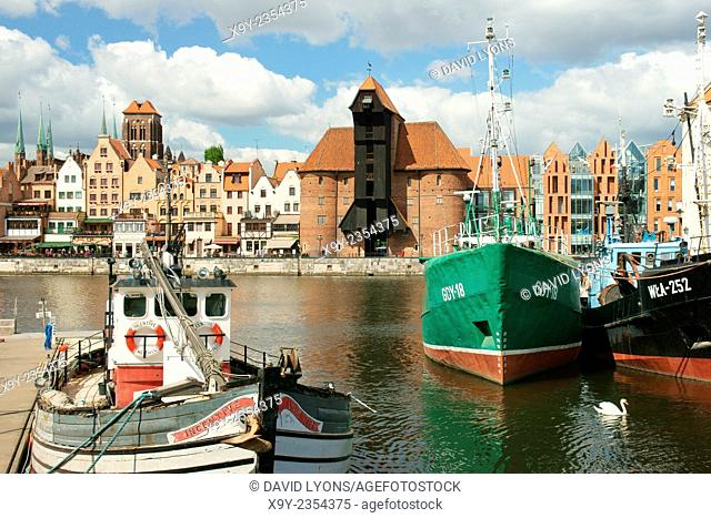 Gdansk Poland. Old Town. Fishing boats on the Motlawa River. Medieval Crane Gate and historic buildings on the Dlugie Pobrzeze