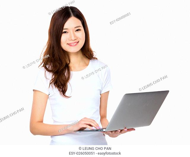 Asian woman use of the laptop computer