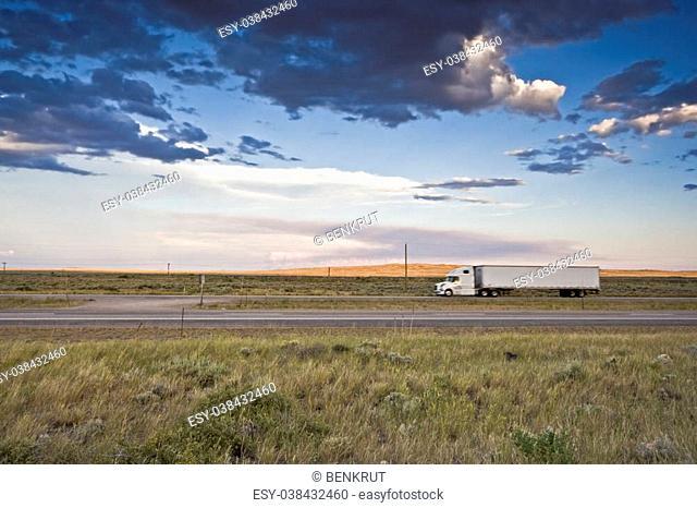 Sunset Ride - blurred Semi-truck