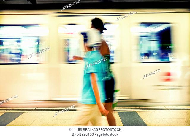 Unrecognizable couple walking on the subway station platform. Barcelona, Catalonia, Spain