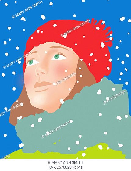 Close up of young woman's face in snow
