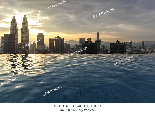Kuala Lumpur, Malaysia - October 21, 2018: Infinity pool in front of the Petronas Towers in the city center