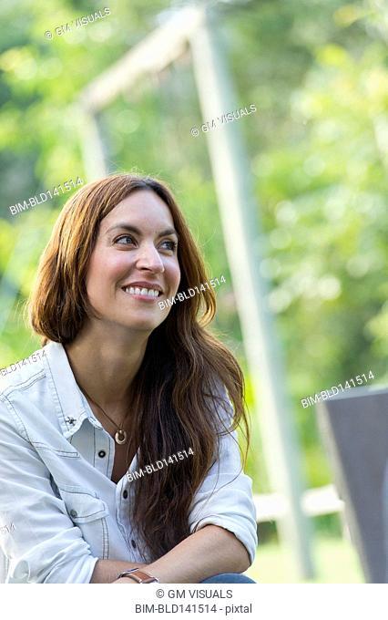 Hispanic woman smiling outdoors