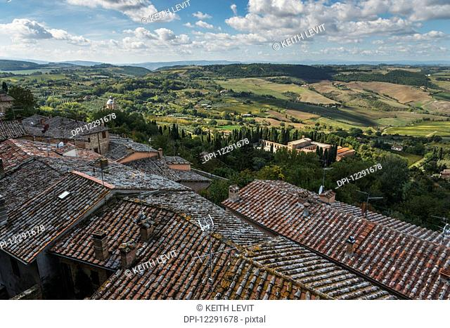 Tile rooftops and a view of the landscape; Montepulciano, Umbria, Italy