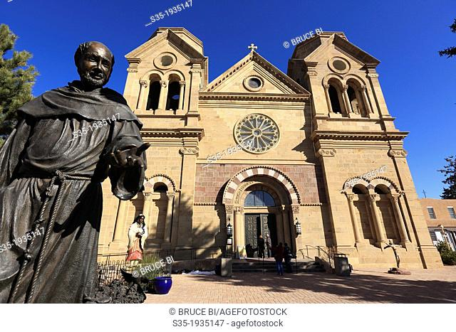 The statue of St. Francis of Assisi the patron saint of Santa Fe in front of the Cathedral Basilica of St. Francis of Assisi. Santa Fe. New Mexico