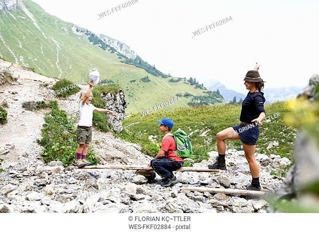 Austria, South Tyrol, family balancing on wood