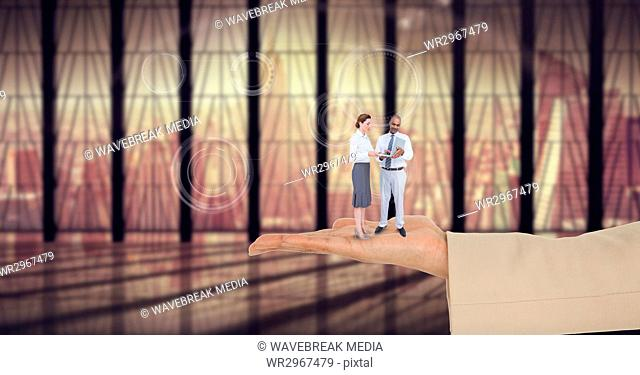 Digital composite image of business people standing on business hand