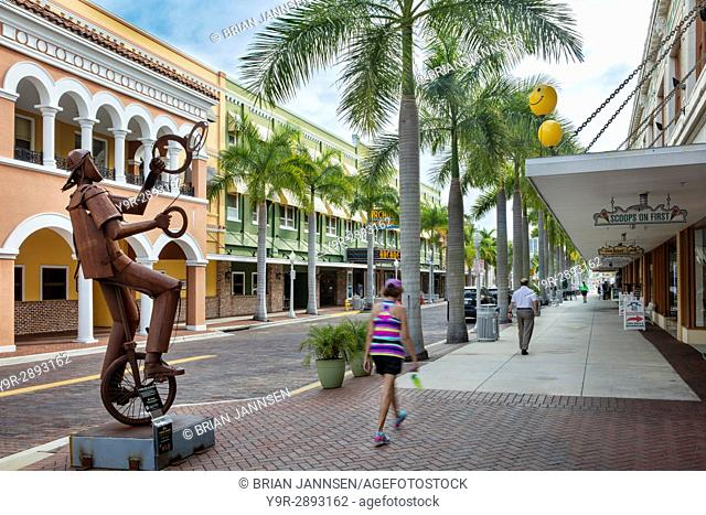 Juggler on a Unicycle - a metal sculpture by Edgardo Carmona on a sidwalk display on First Street, Fort Myers, Florida, USA