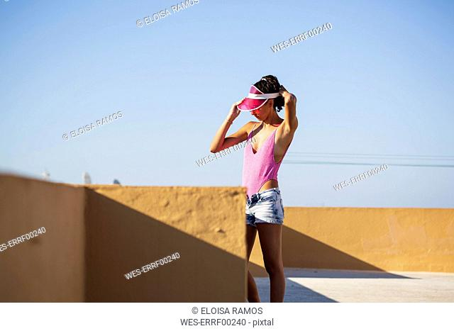 Portrait of teenage girl with pink sunhat